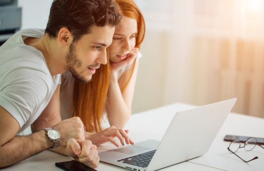 young couple using lap top