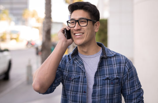 man talking on cell phone and smiling